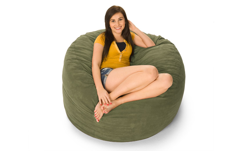A young woman sitting on top of a 4' Fombag