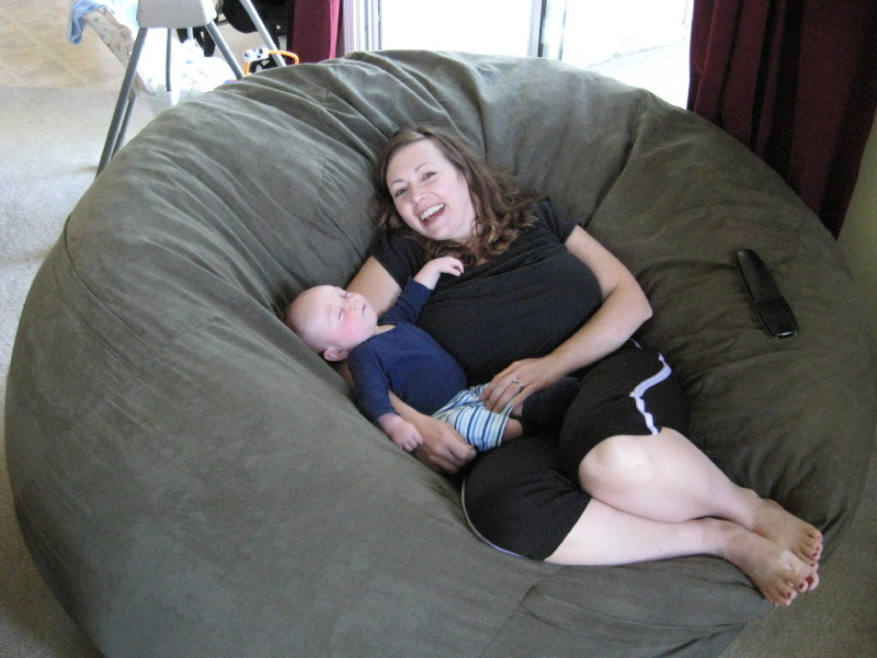 A picture of a mother and her young son relaxing together in the middle of a giant Fombag